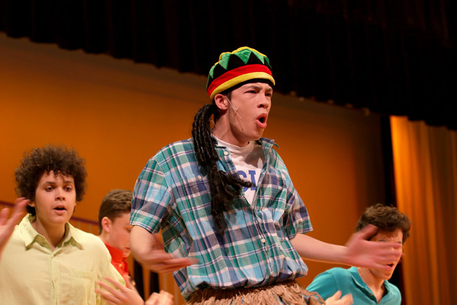 Junior Declan Leach performs a Jamaican song during a party.