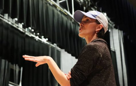 Amber Corriston directs ensemble members during a rehearsal of the school's musical 'Legally Blonde'.