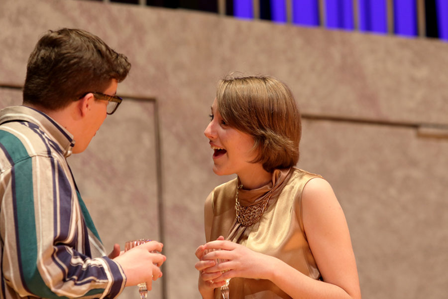 Seniors Noah McIntire and Robin Vogel converse while their characters are at a party.