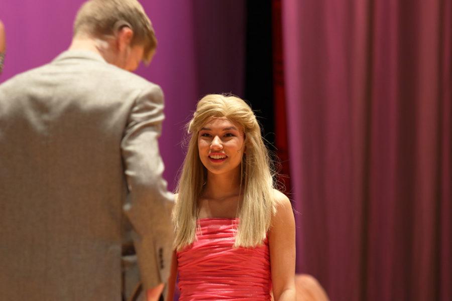 Inouye smiles in excitement as her characters boyfriend, played by senior Weston Hatfield, walks up.