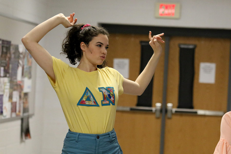 Senior Sophia Thomas warms up before the performance. Thomas is part of several dance numbers during the show.