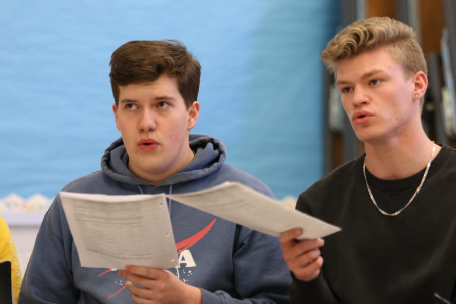 Seniors Noah McIntire and Weston Hatfield sing through one of the given pieces during a Snowcapella rehearsal.