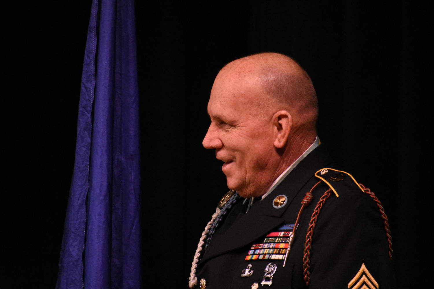 Sergeant+Major+Russel+Wilder+smiles+as+he+watches+students+receive+awards.+