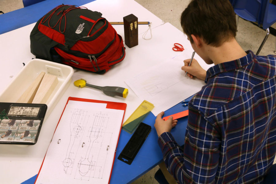 Hermes works on a TSA competition dragster for states.