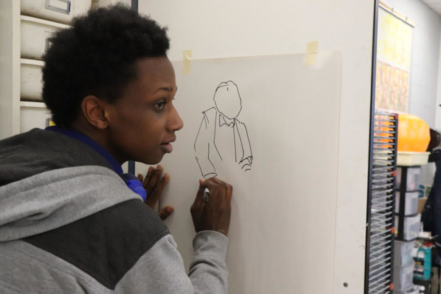 Senior William Walker begins to draw a character for one of his art pieces. Walker previously attended Baltimore School for the Arts before transferring to HHS.