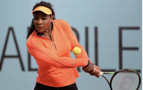 Tennis player Serena Williams serves up the ball at one of her tennis matches. Williams is a professional tennis player who recently released an ad focused around female athletes through Nike.