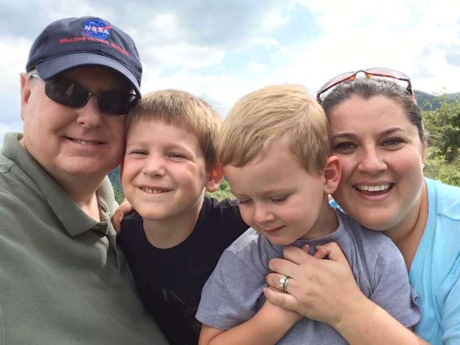 English teacher Sara Gingras takes a selfie with her husband Dan and two sons, Sam and Christopher. Gingras' husband, Dan, passed away in 2018 due to vasculitis, an autoimmune disease that involves the inflammation of the body's blood vessels.