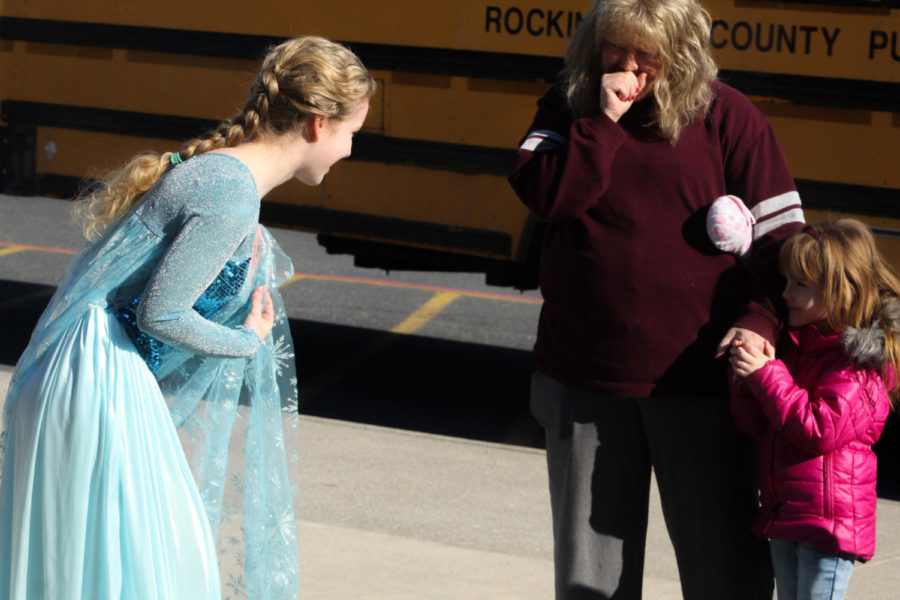 Junior Alice McNett as Elsa talks to a kid as she arrives for the Tiny Tots concert.