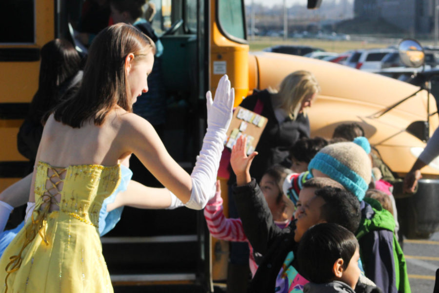 Junior Spencer Spears as Belle prepares to give a high-five.