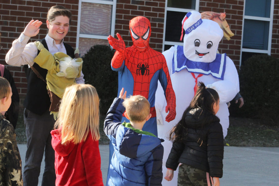 Juniors Leif McCoy and Declan Leach as Han Solo and Spiderman, senior Kaeden Click as Marshmallow Man greet the elementary students as they arrive for the Tiny Tots concert.