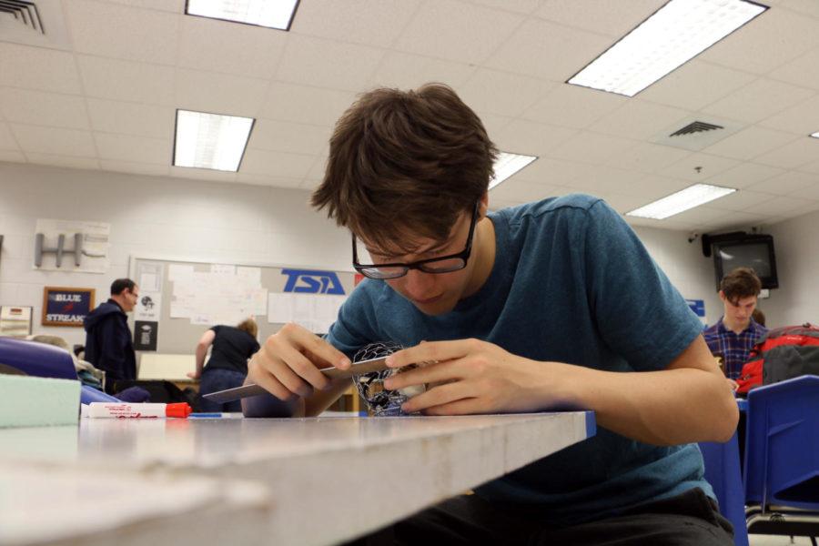 Grant measures an animatronic bird.