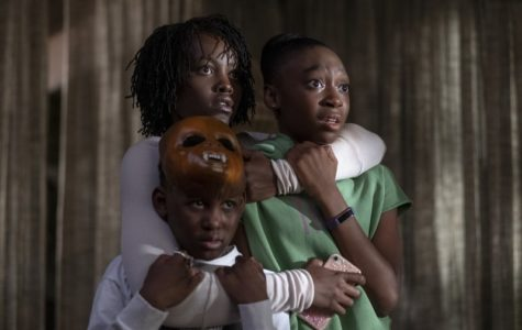 Lupita Nyong'o, Shahadi Wright Joseph and Evan Alex as Adelaide, Zora and Jason Wilson in the film Us.
