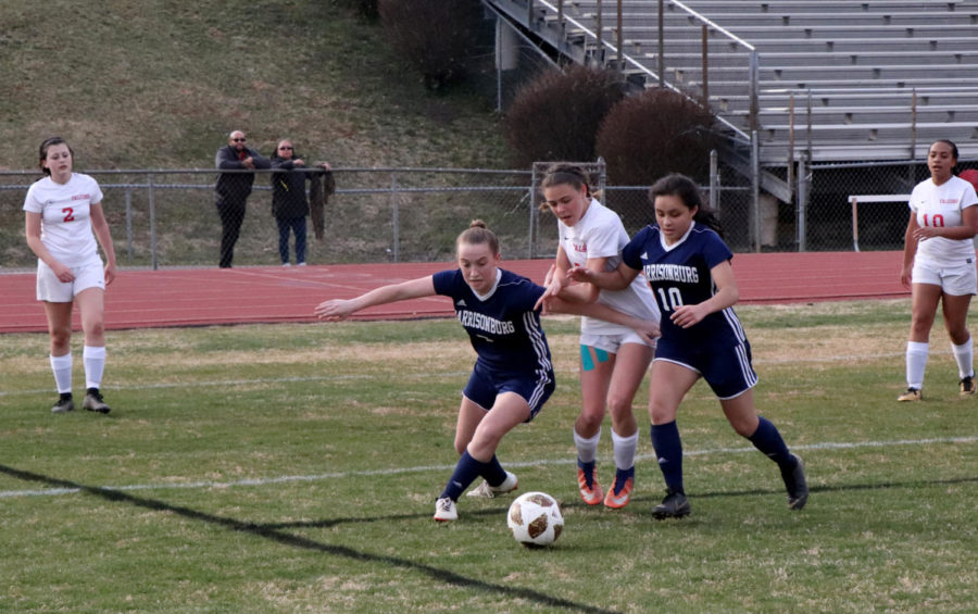 Eighth graders Lily Fleming (left) and Gali Santiago defend against a Fauquier midfielder.
