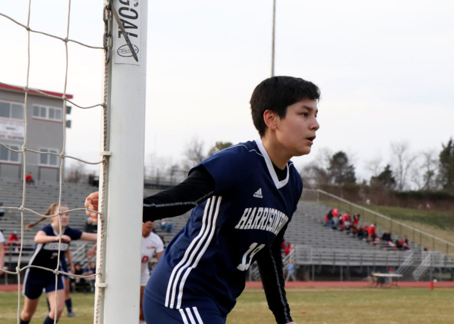 Sophomore Max Bargas Cardoso watches the ball and defends the near post on a corner kick.