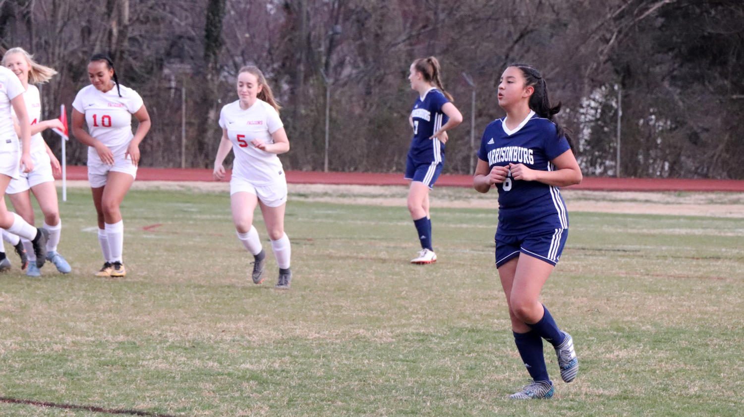 Freshman+Roselyn+Sanchez-Lanza+runs+back+up+the+field+after+the+Falcons+score+their+second+goal+of+the+game.+
