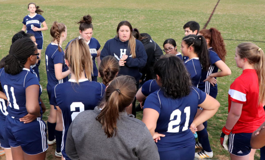 Head coach Becca Borg talks to the team prior to starting the game. The team lost 4-0 after allowing just 1 goal in the second half.