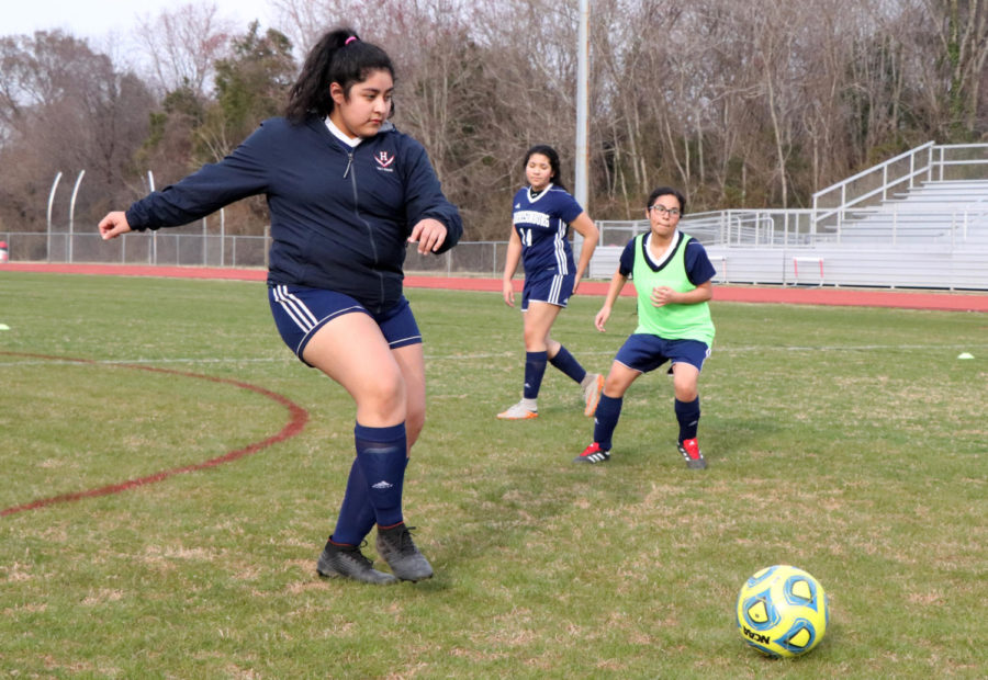 Junior Wendy Santiago looks for an open player to pass to during a possession drill.