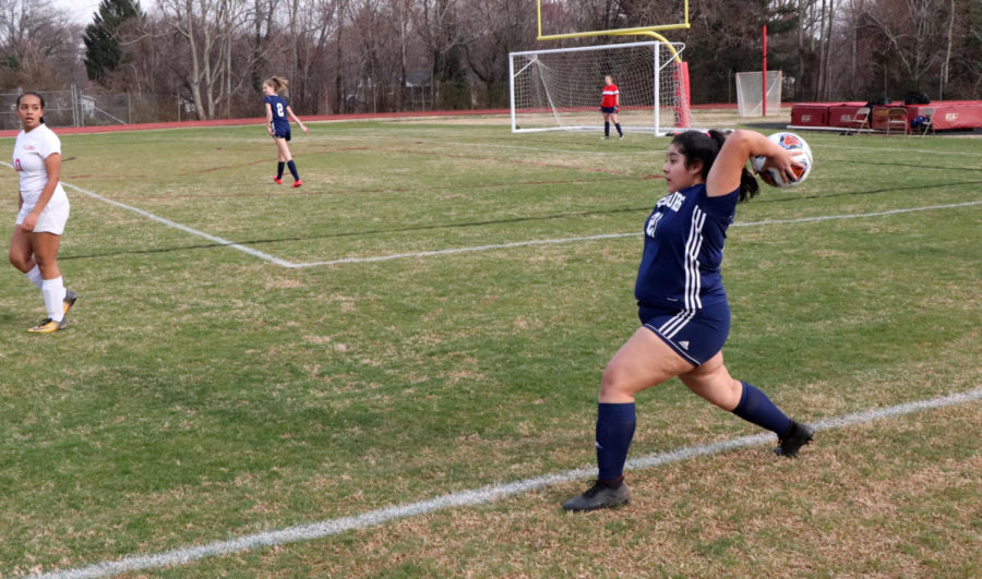 Santiago takes a throw in during the first half.