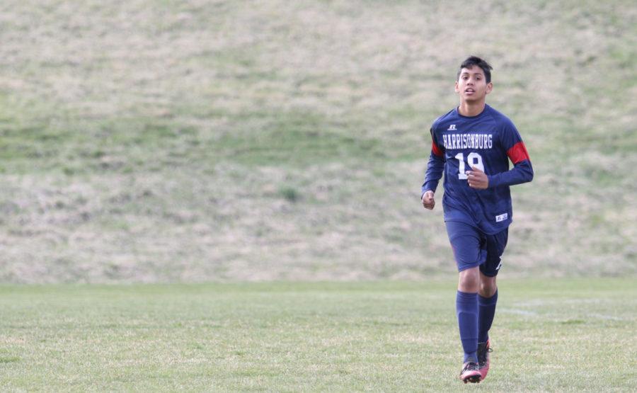 Freshman+Diego+Jimenez+jogs+off+the+field.+