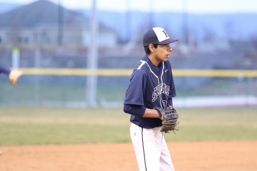 Sophomore+Diego+Gallegos+prepares+for+the+pitch+at+third+base.+