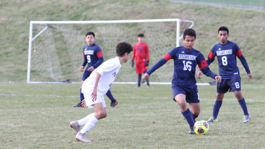Sophomore+Edwin+Rios+dribbles+past+a+Peak+View+player.