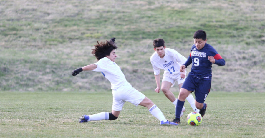 Freshman Marco Bautista-Palacios avoids a tackle.