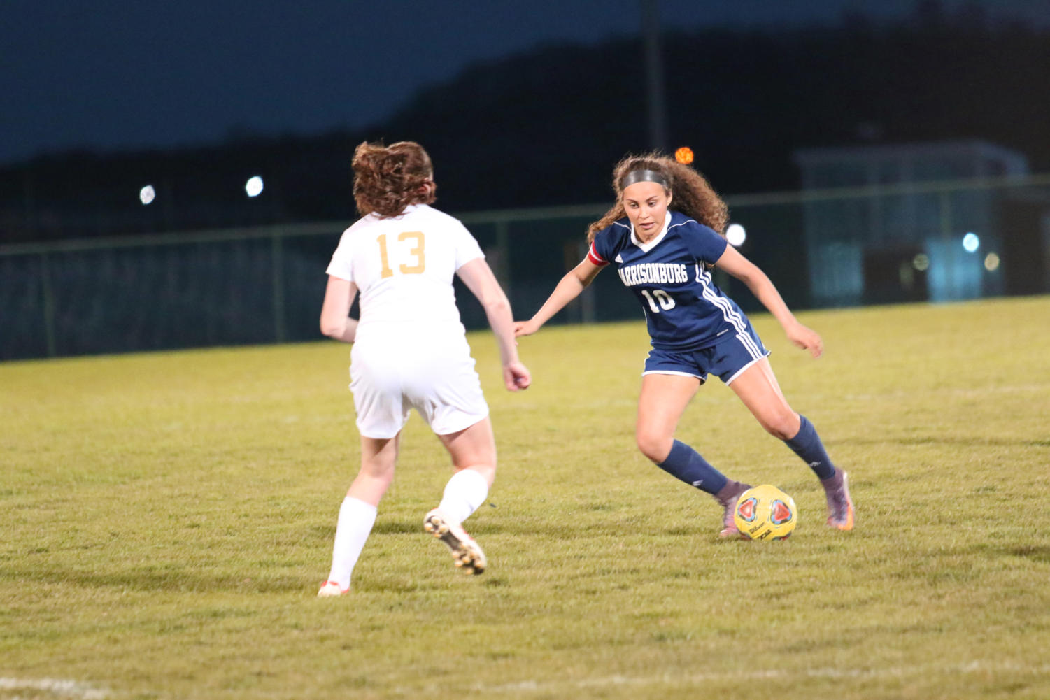 Sophomore Ashley Iscoa takes on a defender as she heads to goal. Iscoa contributed two goals on the night bringing her total to 4 goals this season.