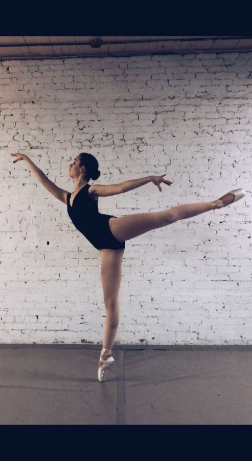 Freshman+Maya+Pope+holds+a+ballet+pose.+She+hopes+one+day+to+become+a+professional+ballet+dancer.+