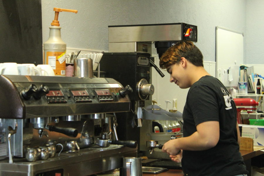 Junior Santiago Pandolfi prepares coffee at Cinnamon Bear Bakery and Deli. Pandolfi has worked at the establishment for seven months now, and even gets to manage it for short periods of time.