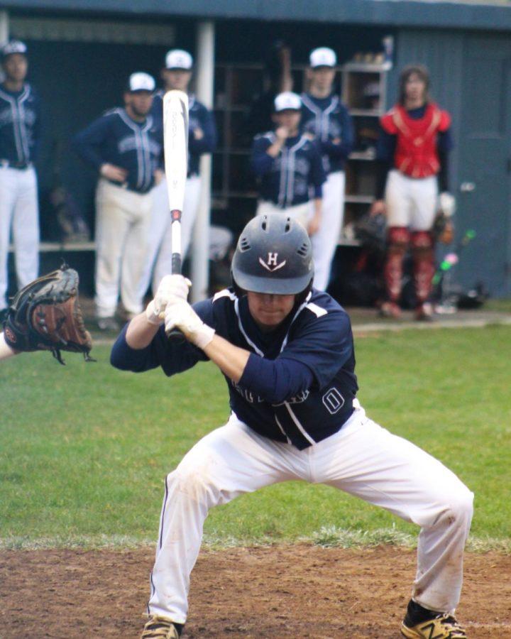 Freshman Dylan Burnette takes a pitch low.