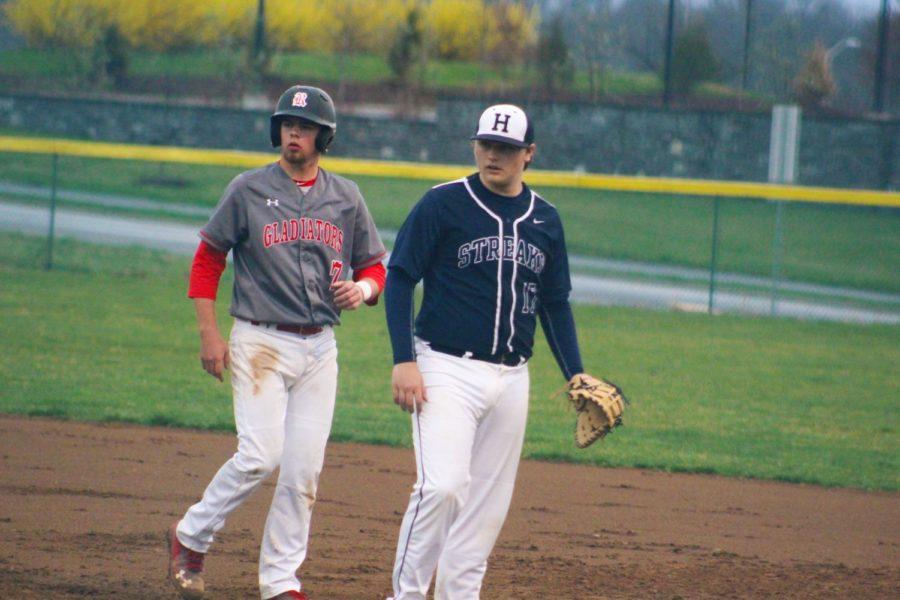 Junior Tristan Fink prepares for a backpick at first base.