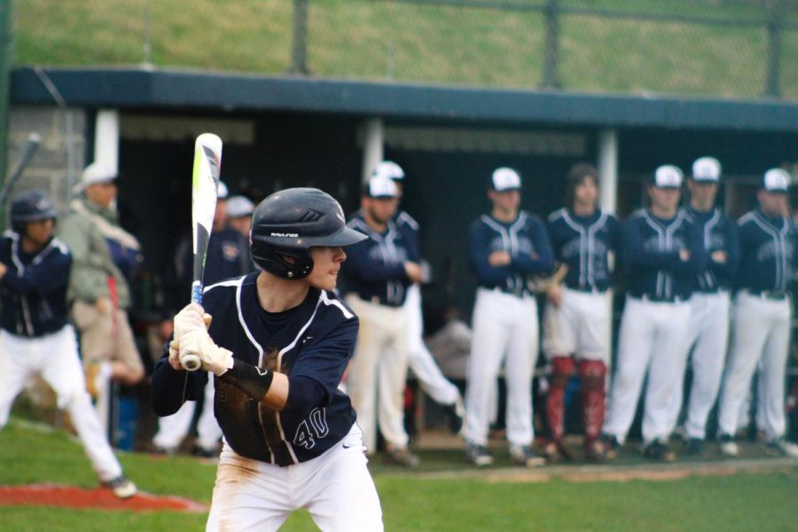 Freshman Zach Cooper prepares to take a swing during his first at bat.