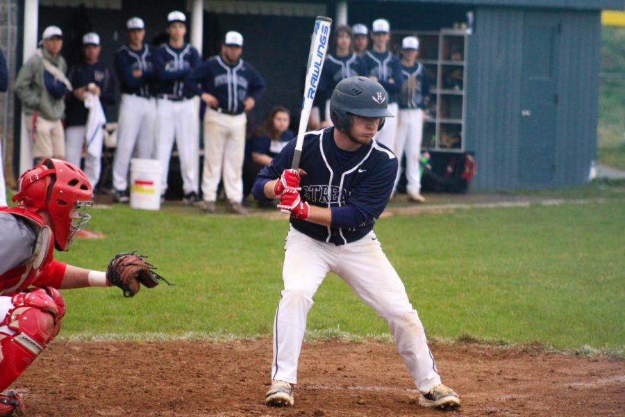 Senior Owen Stewart takes a curveball for a strike.