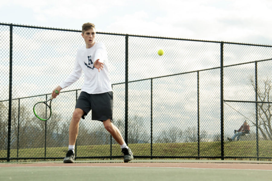 Junior Gabe Eshleman returns a forehand in his match against East Rock's number 6 player.