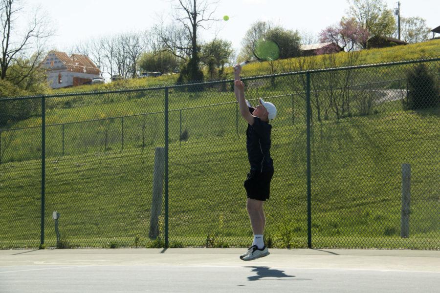 Senior Isaac Mast serves the ball.