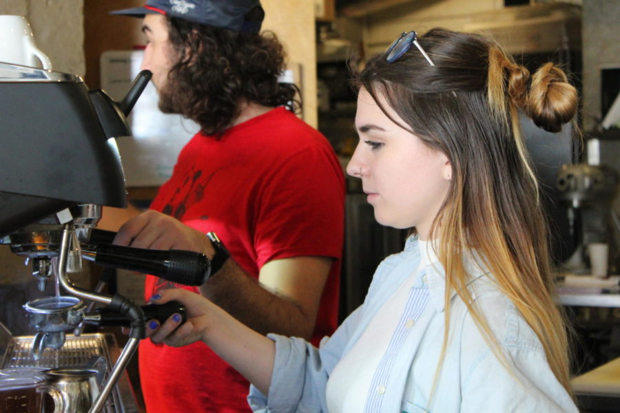 Katherine Ring makes coffee for customers at Black Sheep.