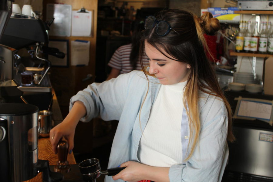 Katherine Ring, an employee of Black Sheep, pours coffee for a customer.