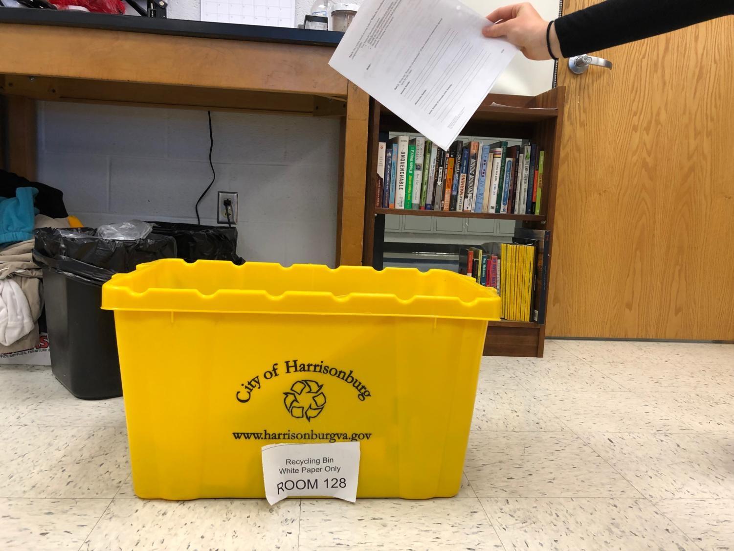 Special education teacher Lisa McQueen started the recycling program and organized the yellow bins with her class.