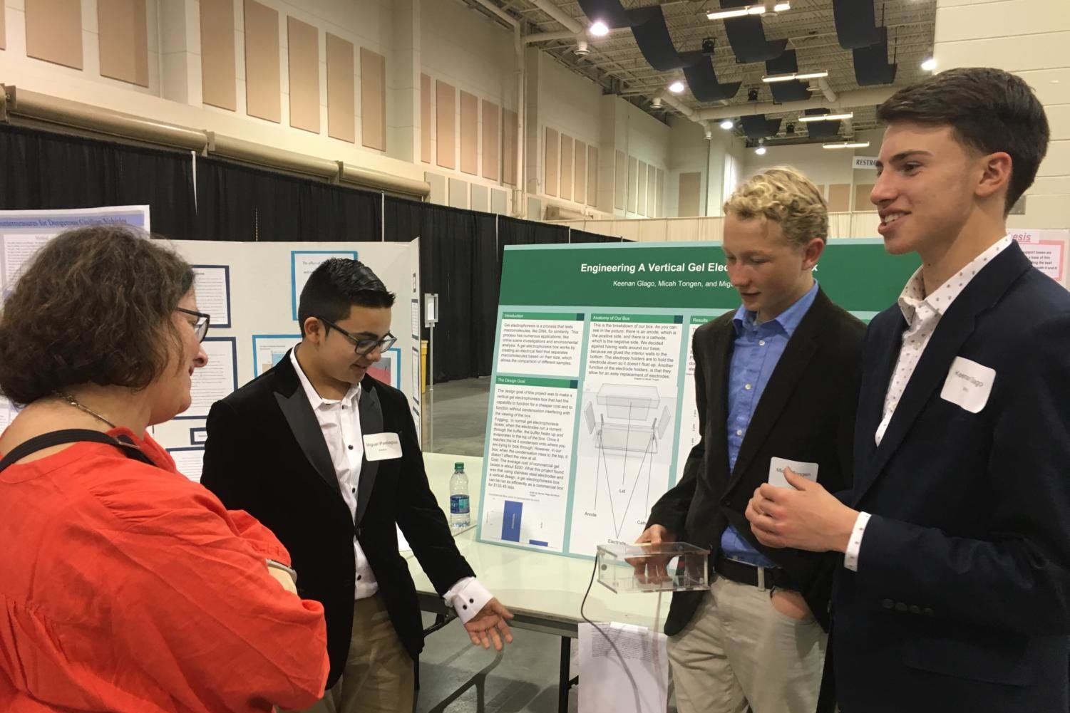 (From left to right) Freshmen Mikey Paniagua, Micah Tongen and Keenan Glago present at the Virginia State Science and Engineering Fair in Roanoke. After three and a half hours of interviewing by judges, the public came to view the different projects.