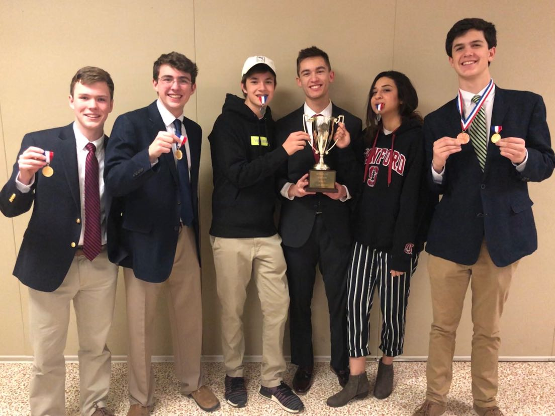 (Left to right) Sophomore Hayden Kirwan, Seniors James Henderson, Samuel Heie, William Daniel, Ganna Aboutable and junior Ritt Culbreth celebrate their victories at VHSL's Regional Tournament. Daniel, Culbreth and Aboutabl all competed at the National Qualifying tournament as well, with Aboutabl placing first and advancing to Nationals.