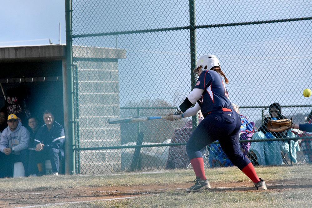 Senior+Ines+Lopez-Flores+strikes+the+ball.