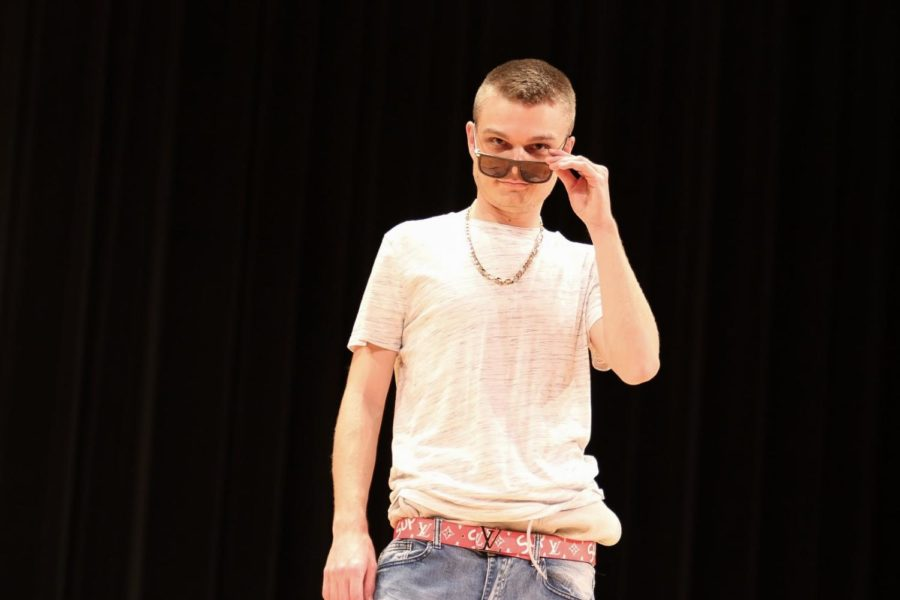 CTE teacher Nicholas Zimmerman poses in his casual outfit.