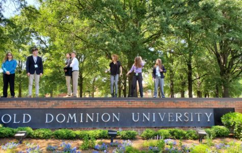 (Left to right) Jade McLeod, Noah McIntire, Fernando Posada, Tucker McGrath, Hannah Miller, Andi Fox and Christa Cole stand atop the sign at Old Dominion University before a presentation.