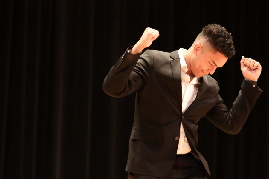 Junior Kevin Arostegui busts a move before the winners are announced.