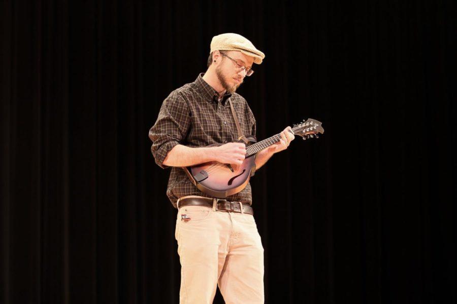 STEM teacher Seth Shantz plays his mandolin for his talent showcase.