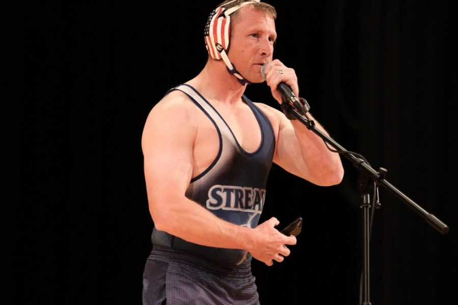 Vice principal Eric Miller wears a wrestling outfit while saying a pick-up line.