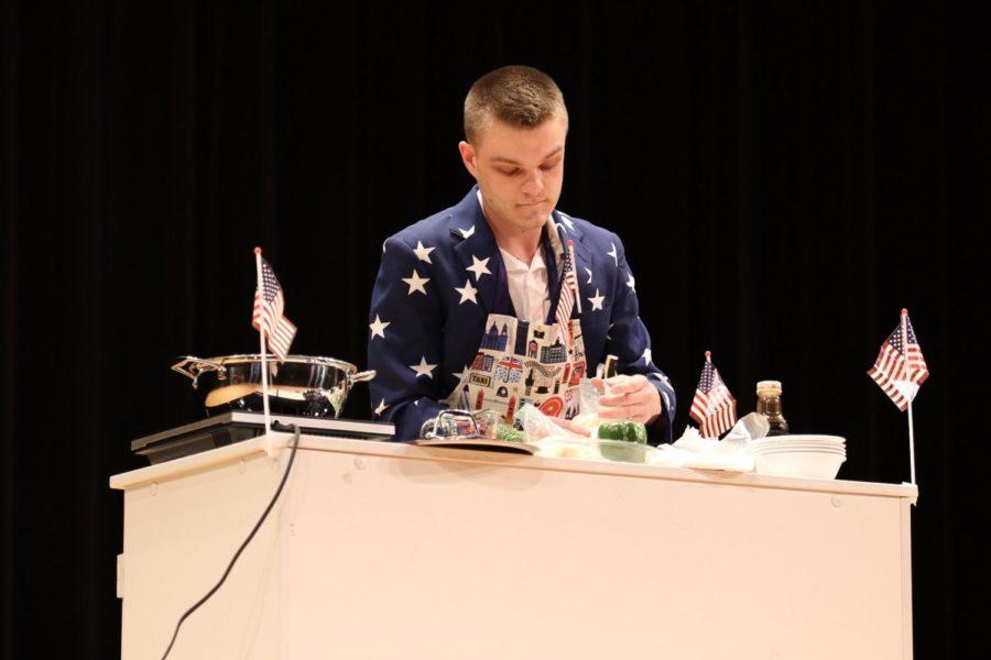 As apart of his talent, CTE teacher Nicholas Zimmerman cooks a soup for the judges.
