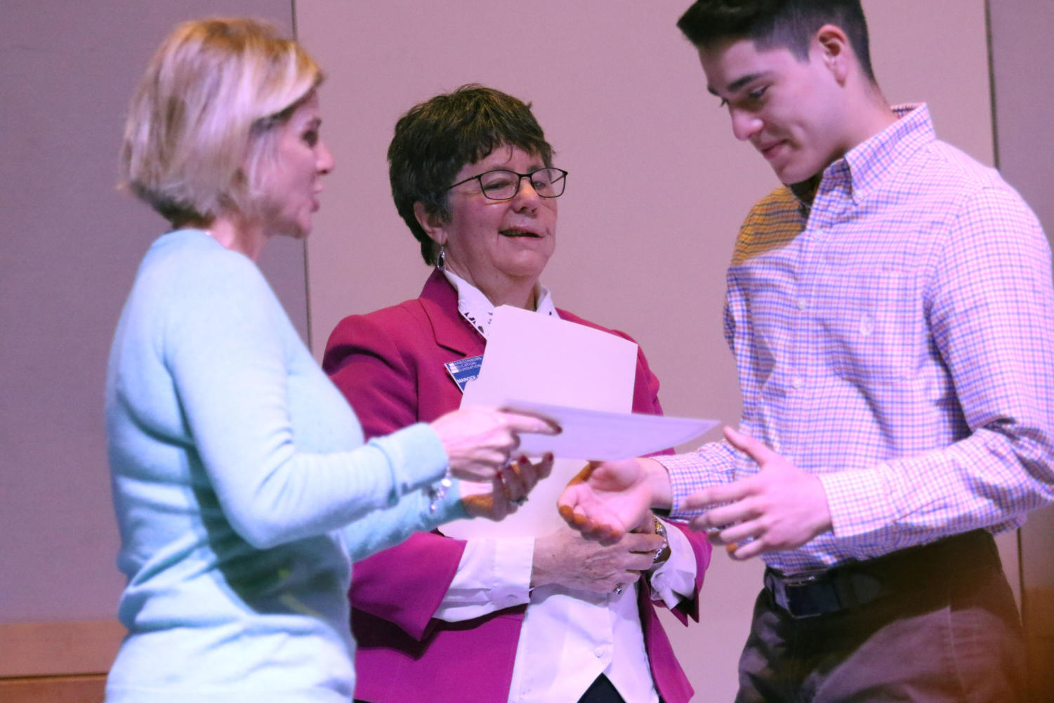 Guillermo Lopez receives the Greg Memorial scholarship grant while attending the Breakfast of Champions.