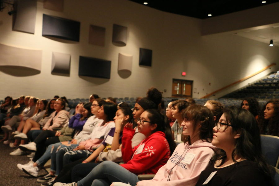Attendees ask questions during the panel.