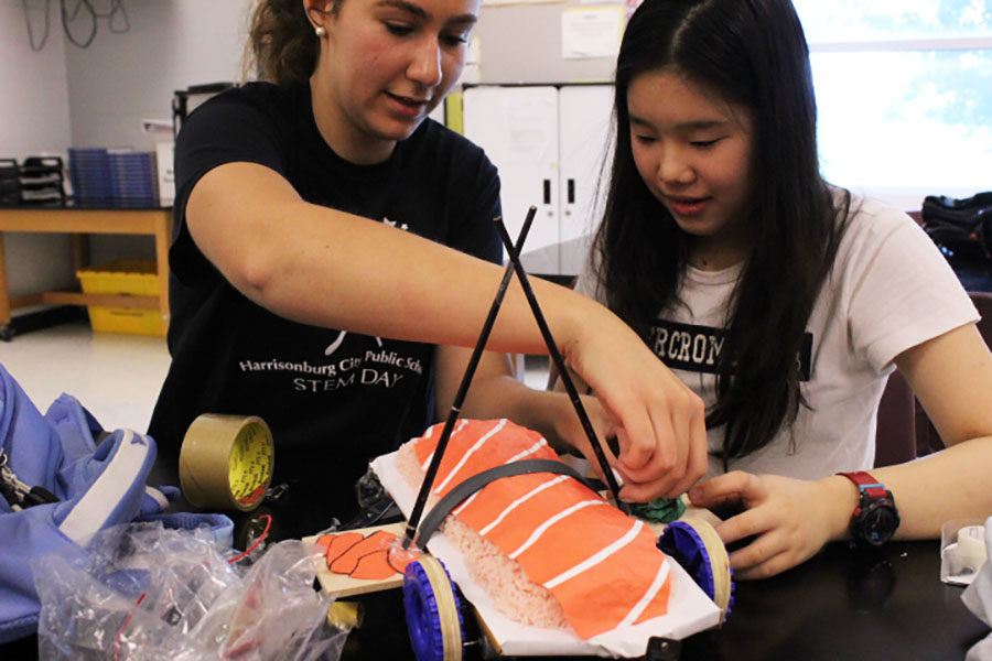 Physics+students+attach+the+chopsticks+to+their+sushi+inspired+car.